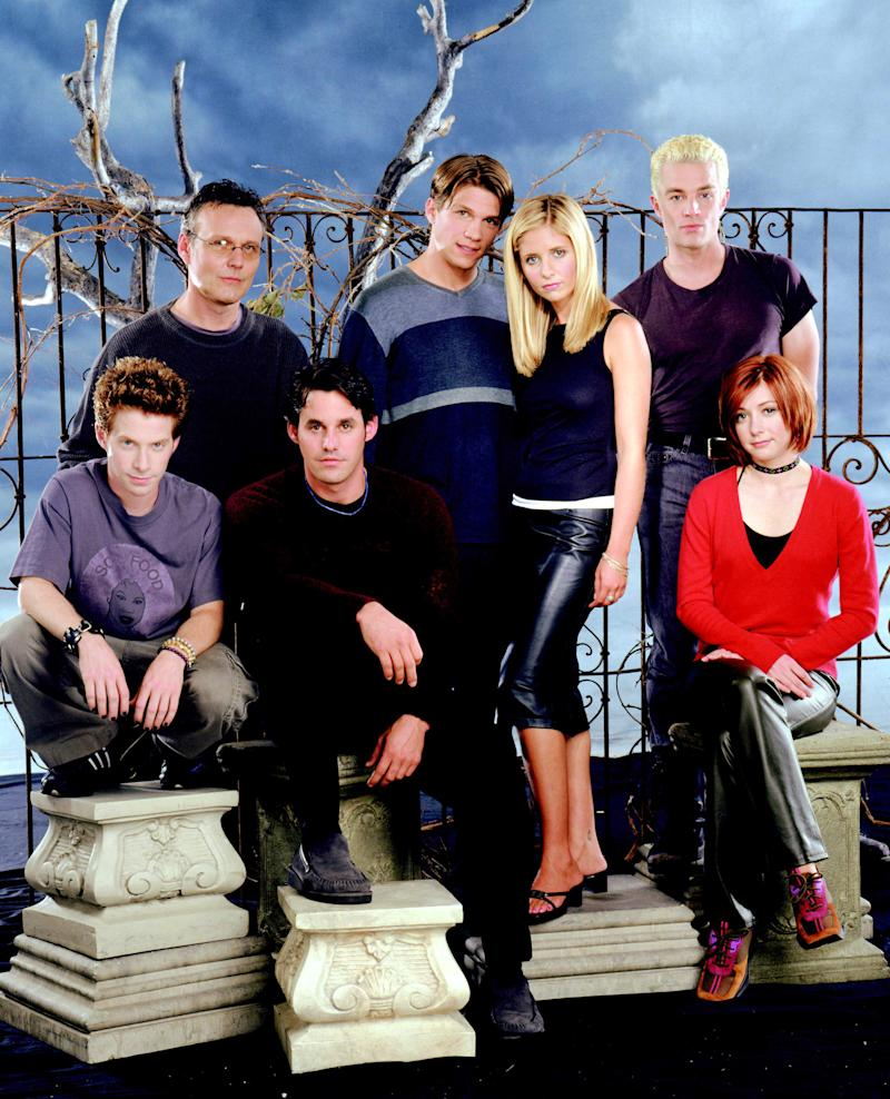 "Alyson Hannigan, right, sits with her ""Buffy the Vampire Slayer"" castmates. in a promotional photo. (Photo: Everett Collection)"