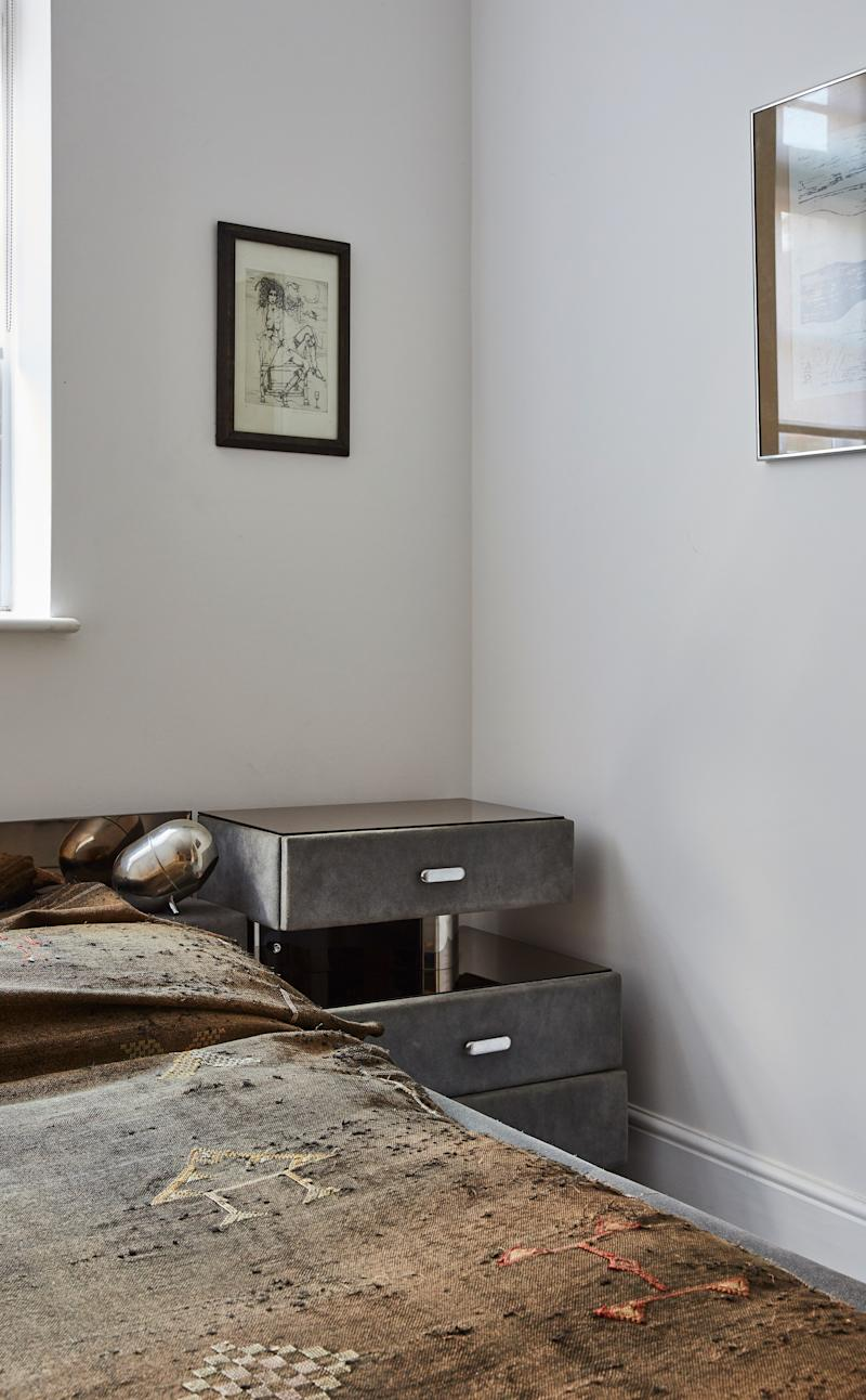 """Mirror-topped nightstands, upholstered in the same blue-gray suede, were included in the purchase of the bed. """"It's all one piece,"""" Cyndia explains. """"It's such a buzz finding really unique one-off stuff like this."""""""