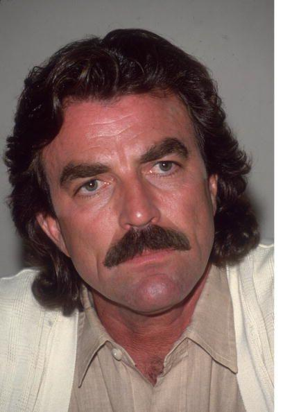 """<p>In the mid-'80s, the <em>Magnum </em><em>P.I. </em>star experimented with growing his hair out to his chin, and we don't hate it. Honestly though Tom Selleck <a href=""""https://www.menshealth.com/grooming/g28566164/celebrity-hair-transformations/"""" rel=""""nofollow noopener"""" target=""""_blank"""" data-ylk=""""slk:could dye his hair blue"""" class=""""link rapid-noclick-resp"""">could dye his hair blue</a> for all we care, as long as that mustache remains in tact. </p>"""
