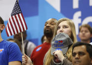 <p>Supporters listen to Democratic U.S. presidential candidate Hillary Clinton at a primary night party in Columbia, S.C., on Saturday. <i> (Photo: Jonathan Ernst/Reuters)</i></p>