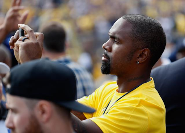ANN ARBOR, MI – SEPTEMBER 03: Former Michigan cornerback Charles Woodson takes a photo prior to a game between the Michigan Wolverines and Hawaii Warriors on September 3, 2016 at Michigan Stadium in Ann Arbor, Michigan. (Photo by Gregory Shamus/Getty Images)