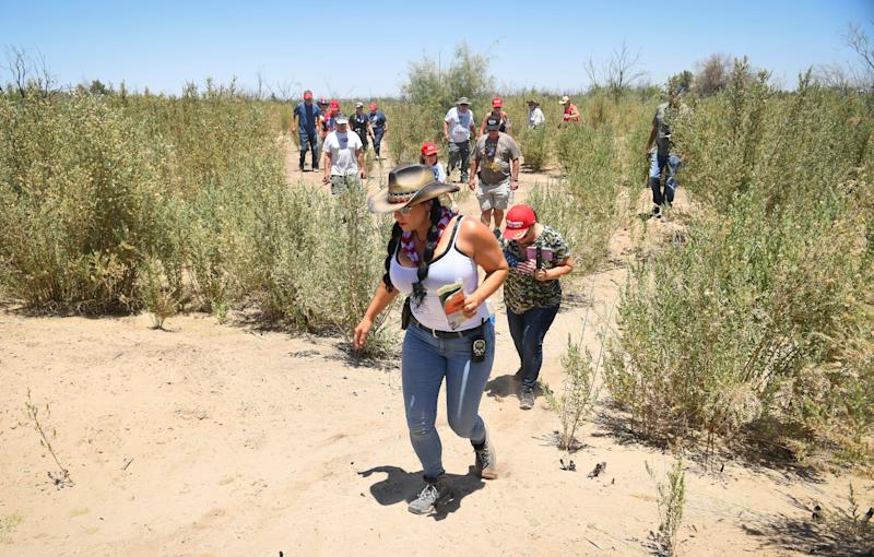 YUMA, Ariz. – Group leader Jennifer Harrison, front, and two dozen members of the AZ Patriots camp out along the Colorado River, where it defines about 24 miles of the U.S.-Mexico border. They took tours of different sections of the border wall and searched for migrants.