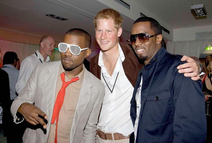 <p>Harry, 22, completes a human sandwich with Kanye West and Diddy at the after-party for a Concert for Diana, which Harry organized with William to celebrate the life of their mother at Wembley Stadium.</p>