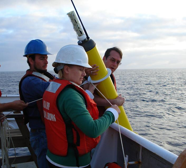 This photo provided by NOAA Corps shows an Argo float being deployed to capture ocean temperature data. (Photo: Lt. Elizabeth Crapo/National Oceanic and Atmospheric Administration via Associated Press)