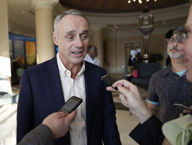 Rob Manfred, commissioner of Major League Baseball, talks to reporters at the end of the day's conferences at MLB baseball owners meetings Thursday, Feb. 7, 2019, in Orlando, Fla. (AP Photo/John Raoux)