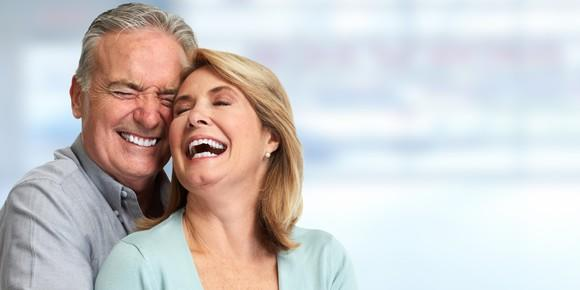 Older couple embracing and laughing