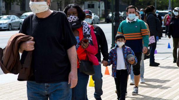 PHOTO: People queue to get free masks distributed by Urban Park Rangers at Grand Army Plaza, during the outbreak of the coronavirus disease (COVID-19) in Brooklyn, New York, May 3, 2020. (Eduardo Munoz/Reuters)