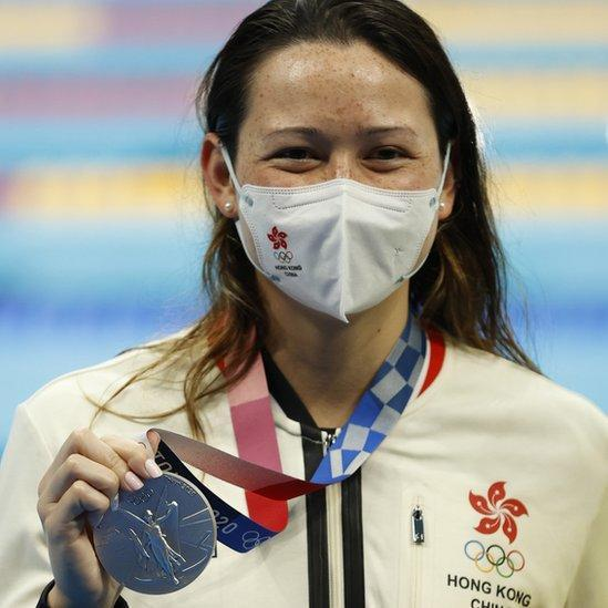 Silver medalist Siobhan Bernadette Haughey of Hong Kong, China who set an Asia record holds her medal at the Women