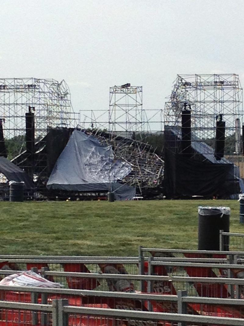 This photo provided by Alexandra Mihan shows a collapsed stage at the site for a Radiohead concert at Downsview Park in Toronto on Saturday June 16, 2012. Toronto paramedics say one person is dead and another is seriously hurt after the stage collapsed while setting up for a Radiohead concert. They say two other people were injured and are being assessed. (AP Photo/Alexandra Mihan via The Canadian Press)