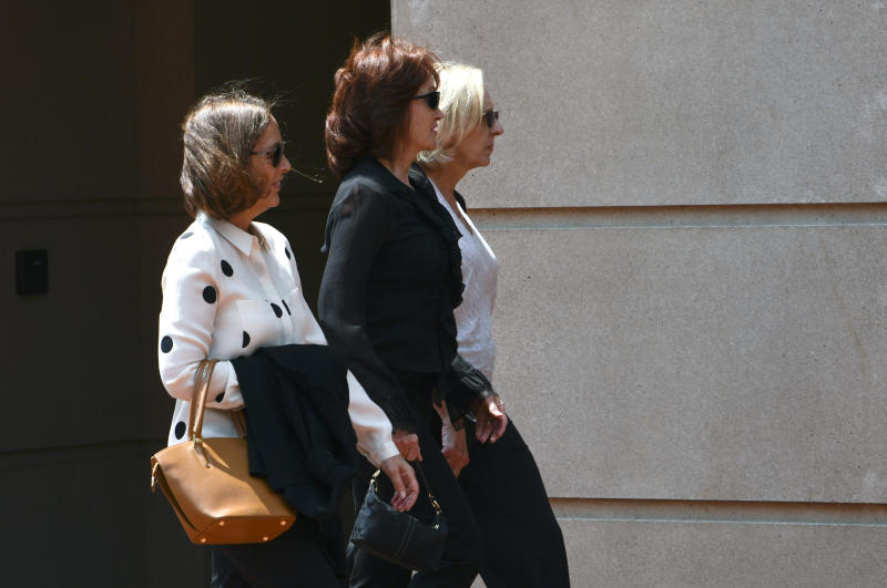 Kathleen Manafort, center, wife of Paul Manafort, walks to the Alexandria Federal Courthouse in Alexandria, Va., Monday, Aug. 6, 2018, for his trial on tax evasion and bank fraud. (AP Photo/Susan Walsh). (AP Photo/Susan Walsh)
