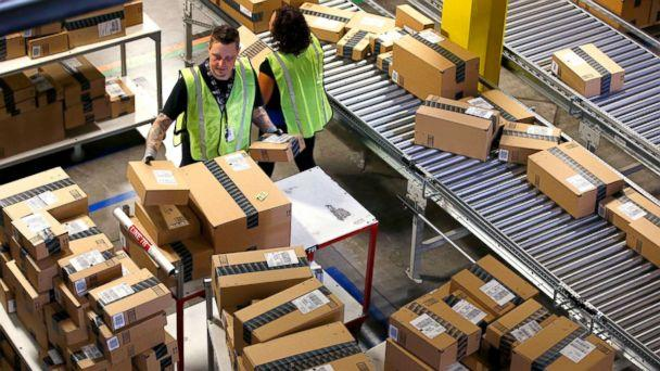 PHOTO: Amazon.com employees organize outbound packages at an Amazon.com Fulfillment Center on 'Cyber Monday' the busiest online shopping day of the holiday season, in Phoenix, Dec. 2, 2013. (Ross D. Franklin/AP, FILE)