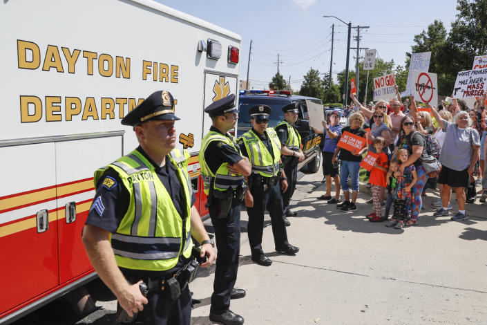 Police block the street as demonstrators protest the arrival of President Donald Trump outside Miami Valley Hospital after a mass shooting that occurred in the Oregon District early Sunday morning, Aug. 7, 2019, in Dayton. (Photo: John Minchillo/AP)