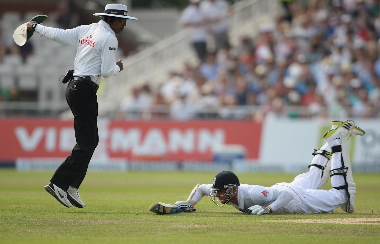 NOTTINGHAM, ENGLAND - JULY 12:  Umpire Kumar Dharmasena takes evasive action as Stuart Broad of England dives to make his ground during day three of the 1st Investec Ashes Test match between England and Australia at Trent Bridge Cricket Ground on July 12, 2013 in Nottingham, England.  (Photo by Gareth Copley/Getty Images)