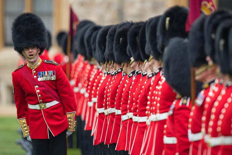 Troops stand to attention at a medal presentation ceremony and parade for the Grenadier Guards at Windsor Castle, Berkshire.