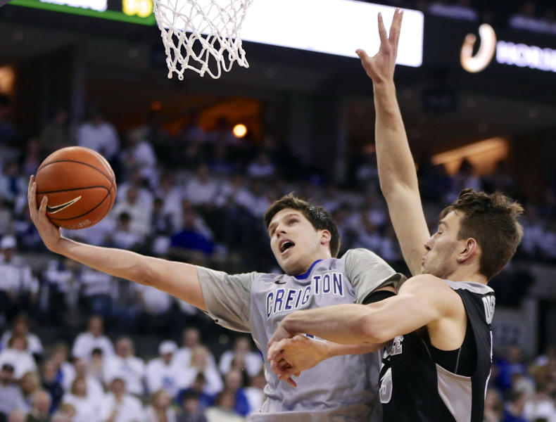 FILE- In this March 8, 2014, file photo, Creighton's Doug McDermott (3) goes for a layup against Providence's Carson Desrosiers, right, in the second half of an NCAA college basketball game in Omaha, Neb. McDermott was selected as one of the top college basketball players of the decade. (AP Photo/Nati Harnik, File)