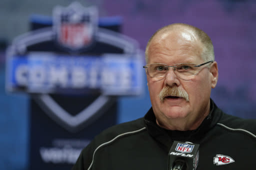 FILE - In this Feb. 25, 2020, file photo, Kansas City Chiefs head coach Andy Reid speaks during a press conference at the NFL football scouting combine in Indianapolis. Andy Reid is like most people these days. The Kansas City Chiefs coach is hunkered down in his basement, trying to avoid going out in public as he works from a makeshift office consisting of a computer, an iPad and an old side table. The difference, though: He's trying to build a team that can defend a Super Bowl title. (AP Photo/Michael Conroy, File)