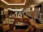 """<p><strong>How did it strike you on arrival?</strong><br> There's a second—and third—layer of luxury to any Shangri-La Hotel, and as it approaches its 10-year anniversary in Tokyo, the opulence still shines. Sure, it might mesh with Japan's minimalist aesthetic like a Rolls-Royce at a Honda dealership (over 50 chandeliers, just one of which is over 30 feet long, tend to outshine the classic paper lantern), but if shiny surfaces are your fancy, there's no short supply.</p> <p><strong>What's the crowd like?</strong><br> International jet-set with a taste for all that glitters.</p> <p><strong>The good stuff: Tell us about your room.</strong><br> """"Small"""" isn't part of Shangri-La's vocabulary unless it's followed by """"fortune."""" As such, the rooms are some of Tokyo's most spacious and grandest. The Deluxe Imperial Garden View, as its name suggests, comes with wall-to-wall windows overlooking the <a href=""""https://www.cntraveler.com/activities/tokyo/tokyo-imperial-palace?mbid=synd_yahoo_rss"""" rel=""""nofollow noopener"""" target=""""_blank"""" data-ylk=""""slk:Imperial Palace,"""" class=""""link rapid-noclick-resp"""">Imperial Palace,</a> surveyed from a curvy sofa built into the corner. The confines are palatial, outfitted with rich materials ranging from burgundy and light wood paneling to lavish textures right down to the plush gold-hued carpet.</p> <p><strong>We're craving some deep, restorative sleep. They got us?</strong><br> The Stearns & Foster mattress guarantees the decadent night's sleep you'd expect from a five-star hotel.</p> <p><strong>How about the little things, like mini bar, or shower goodies. Any of that find its way into your suitcase?</strong><br> The mini-bar stocks all the comforts you might expect, plus pricey Japanese whisky (it hardly matters which hotel we're talking about—we'd always nip a bottle or two). There are items like stationery and slippers, naturally, and, arriving with turn-down service, a pair of pajamas round out the perks.</p> <p><strong>Please tell us the b"""