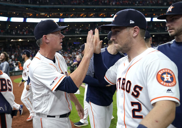 Houston Astros manager AJ Hinch, left, celebrates with Alex Bregman (2) after a baseball game against the Chicago Cubs Tuesday, May 28, 2019, in Houston. The Astros won 9-6. The win was Hinch's 500th career victory. (AP Photo/David J. Phillip)