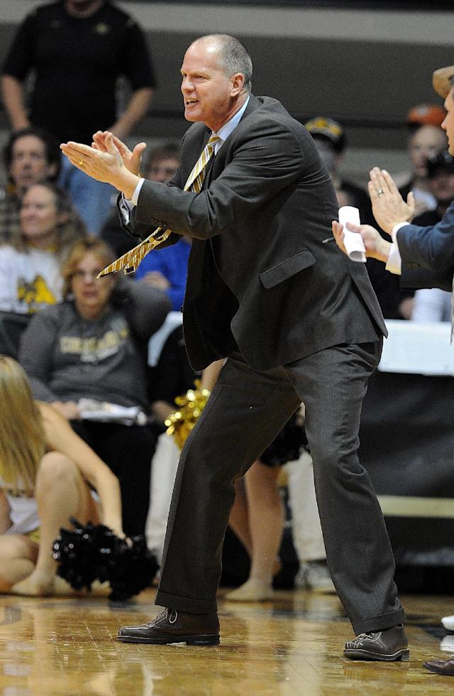 Colorado head coach, Tad Boyle tries to get his team going during the first half of an NCAA college basketball game againt Utah Saturday, Feb. 1, 2014, in Boulder, Colo. (AP Photo/The Daily Camera, Cliff Grassmick)