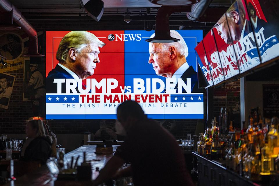 Television screens airing the first presidential debate are seen at Walters Sports Bar in Washinton.