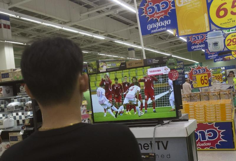 Thai junta to 'return happiness' through World Cup