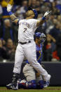 Milwaukee Brewers' Eric Thames reacts after his three-run home run against the Chicago Cubs during the third seventh of a baseball game Friday, April 5, 2019, in Milwaukee. (AP Photo/Jeffrey Phelps)