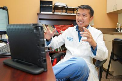 Kenneth Ngo, MD, Medical Director and board-certified physical medicine and rehabilitation physician at Brooks Rehabilitation in Jacksonville, Fla., conducts telehealth visits with patients during the COVID-19 pandemic. (PRNewsfoto/Brooks Rehabilitation)