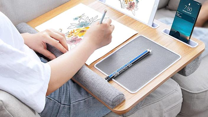 This lap desk provides comfortable padding for overworked wrists and laid-out legs.