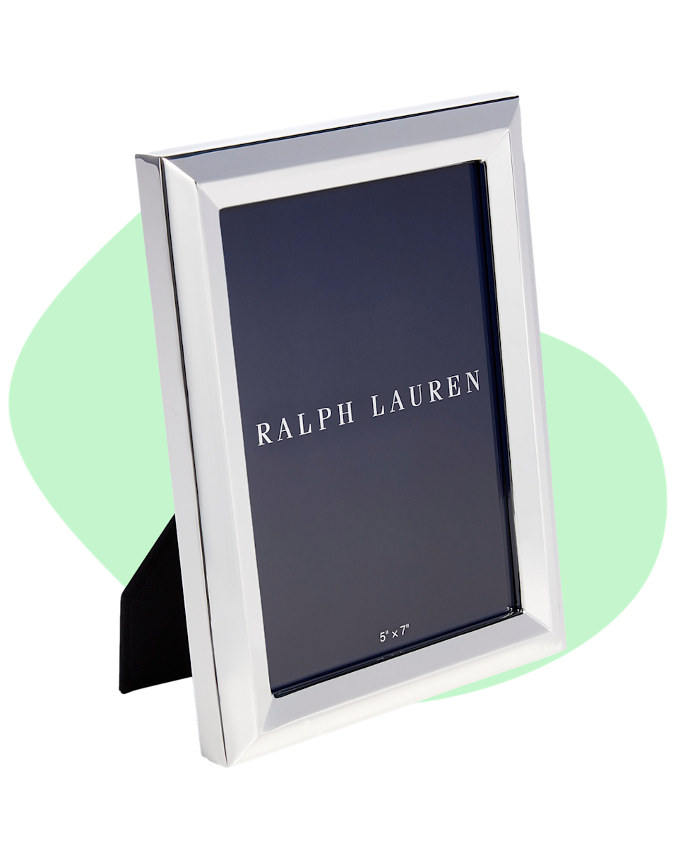 """A Ralph Lauren picture frame is a great gift—put your favorite picture of you and your mom in it and we guarantee it will put a smile on her face. She can put it on her night stand, in the living room or in her office as a chic way to showcase your love for her. $15, Ralph Lauren. <a href=""""https://www.ralphlauren.com/home-decor-frames/marcus-frame/453571.html?dwvar453571_colorname=Silver&webcat=search#lang=en_US&q=Frame%2B&start=1"""" rel=""""nofollow noopener"""" target=""""_blank"""" data-ylk=""""slk:Get it now!"""" class=""""link rapid-noclick-resp"""">Get it now!</a>"""