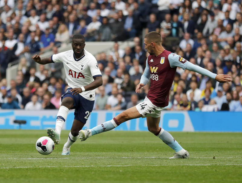 Tottenham's Tanguy Ndombele, left, duels for the ball with Aston Villa's Conor Hourihane during the English Premier League soccer match between Tottenham Hotspur and Aston Villa at the Tottenham Hotspur stadium in London, Saturday, Aug. 10, 2019. (AP Photo/Frank Augstein)