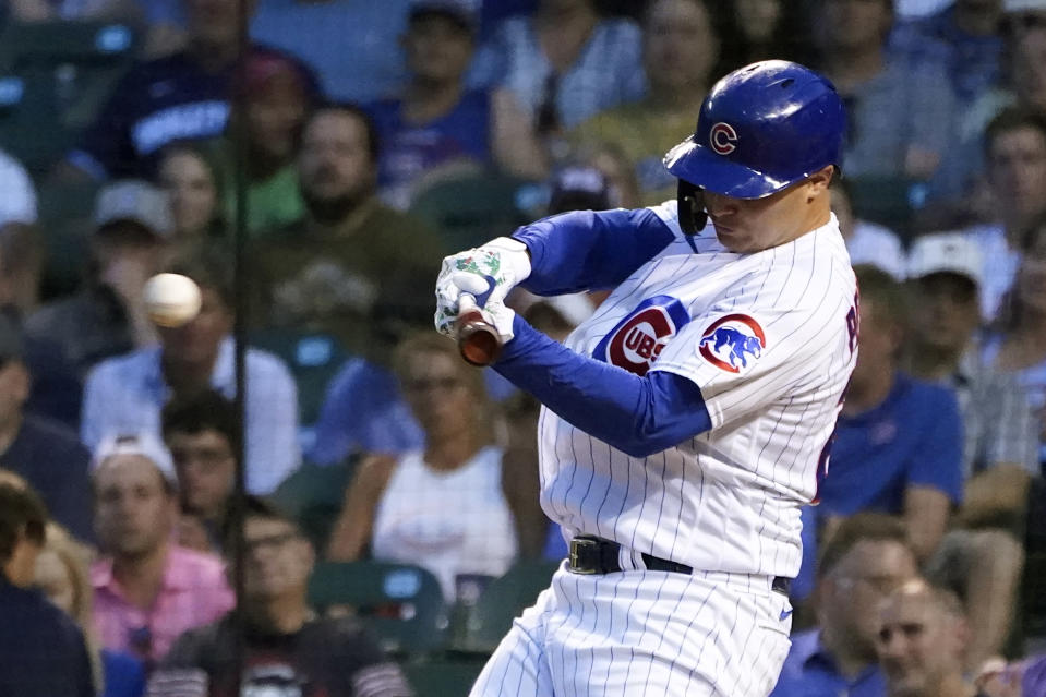 Chicago Cubs' Joc Pederson hits an RBI double off Philadelphia Phillies starting pitcher Aaron Nola during the third inning of a baseball game Tuesday, July 6, 2021, in Chicago. Sergio Alcantara scored on the play. (AP Photo/Charles Rex Arbogast)