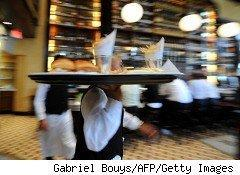 Waiter delivers a tray of food