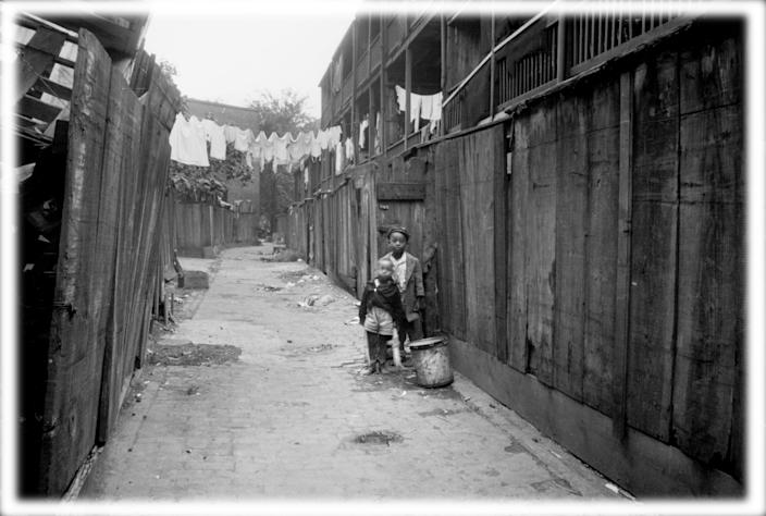 Two boys in an alley in Washington, D.C., photographed by the U.S. Resettlement Administration in 1935. (Photo: Circa Images/Glasshouse via ZUMA Wire; digitally enhanced by Yahoo News)