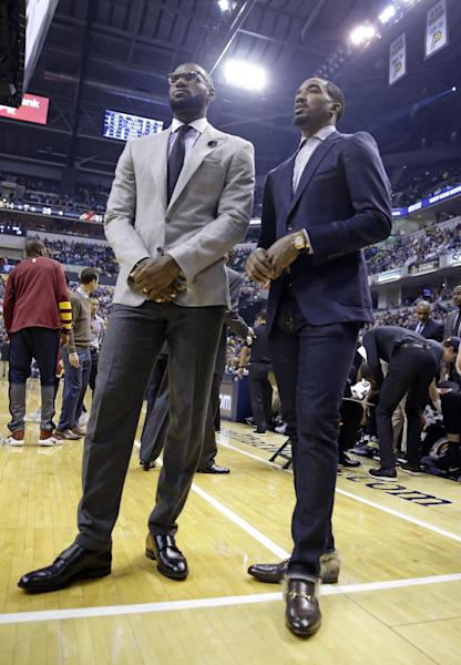 Cleveland Cavaliers forward LeBron James, left, and guard J.R. Smith stand on the court during a timeout in the first half of the team's NBA basketball game against the Indiana Pacers in Indianapolis, Wednesday, Nov. 16, 2016. (AP Photo/Michael Conroy)