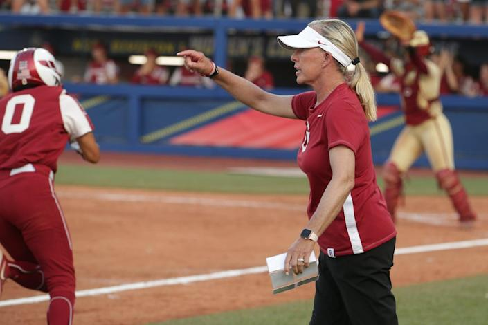 OKLAHOMA CITY, OK - JUNE 09: Head coach Patty Gasso of the Oklahoma Sooners directs her team from the third base line during the Division I Women's Softball Championship held at ASA Hall of Fame Stadium on June 9, 2021 in Oklahoma City, Oklahoma. (Photo by Shane Bevel/NCAA Photos via Getty Images)