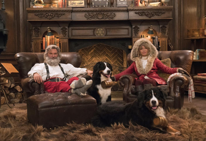 """This image released by Netflix shows Kurt Russell, left, and Goldie Hawn from the holiday film """"The Christmas Chronicles: Part Two,"""" premiering Friday on Netflix. (Michael Gibson/Netflix via AP)"""