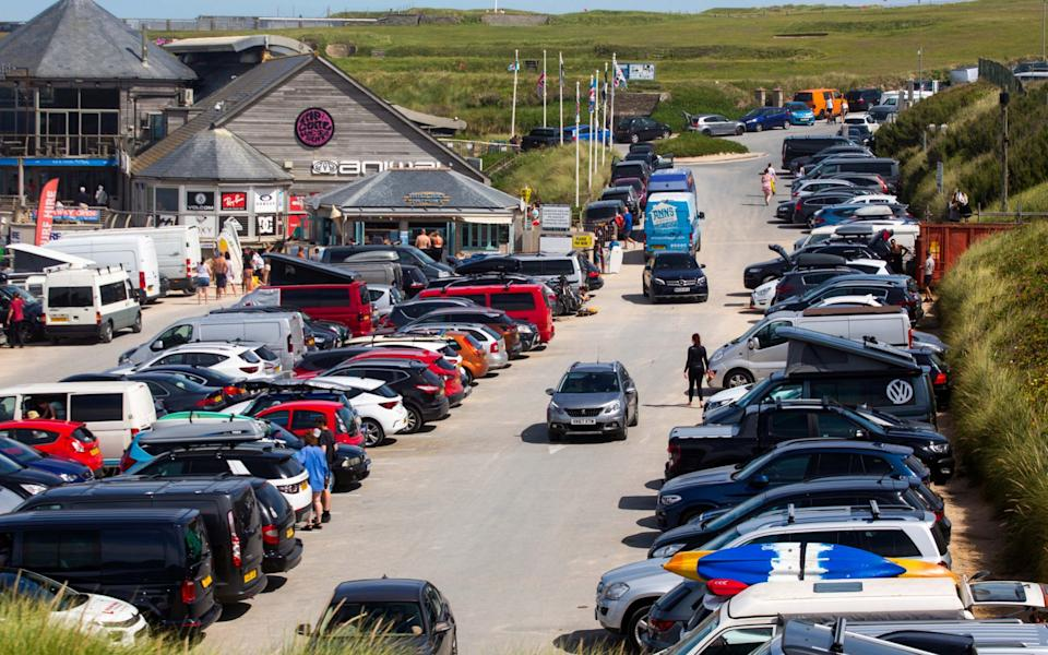 A full carpark at Fistral beach in Cornwall. - South West News Service