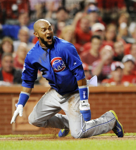 Chicago Cubs' Emilio Bonifacio reacts after being called out at the plate against the St. Louis Cardinals in the fourth inning in a baseball game, Monday, May 12, 2014, at Busch Stadium in St. Louis. The call was reversed after a challenge review. (AP Photo/Bill Boyce)
