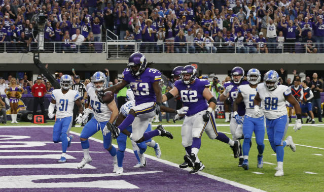 "<a href=""https://sports.yahoo.com/nfl/teams/min"" data-ylk=""slk:Minnesota Vikings"" class=""link rapid-noclick-resp"">Minnesota Vikings</a> running back Dalvin Cook scores on a 5-yard touchdown run against the Detroit Lions. (AP Photo)"