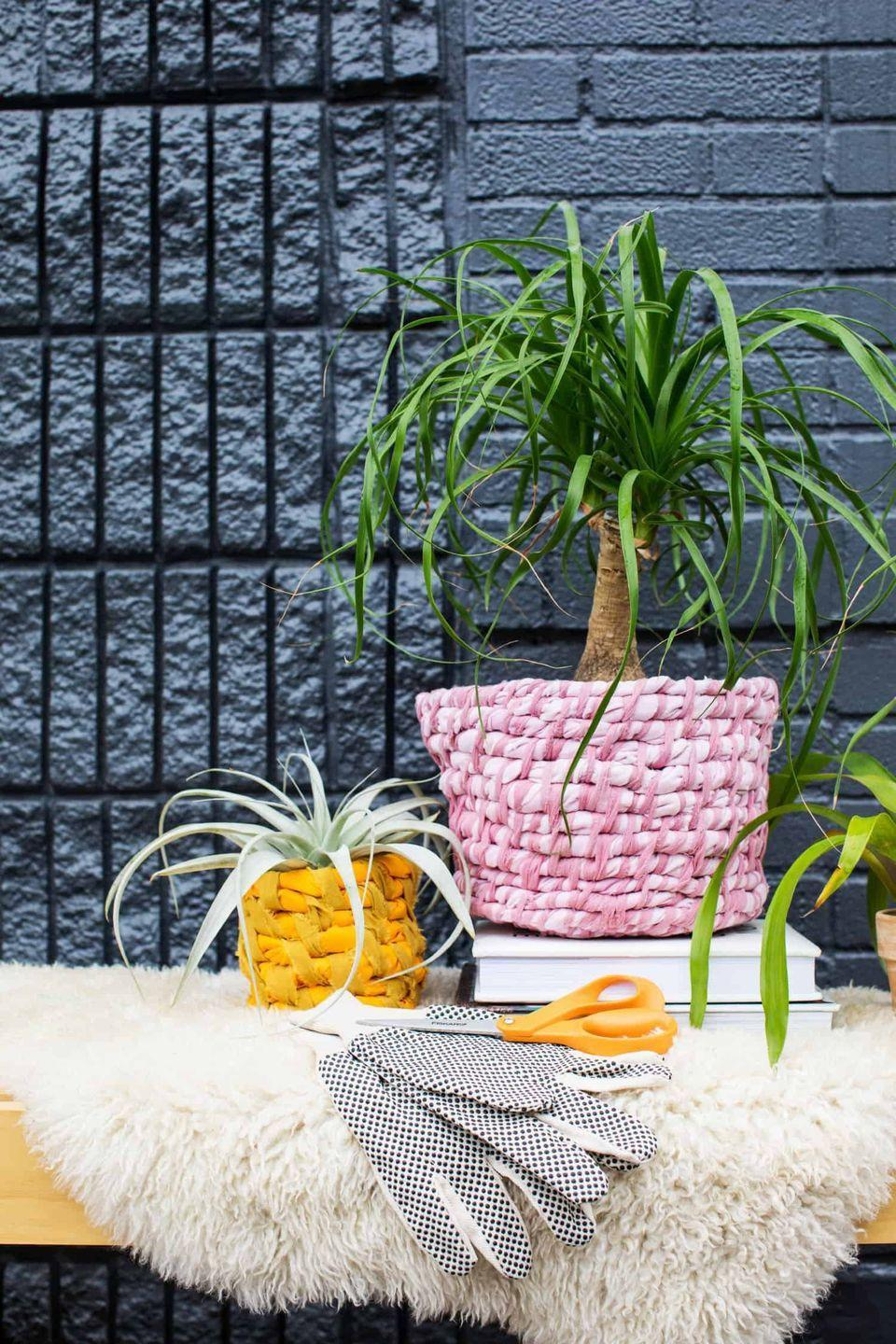 """<p>Fabric has become the material of choice for many modern planters. It looks particularly appealing in these shades of pink and orange. </p><p><strong>Get the tutorial at <a href=""""https://abeautifulmess.com/easy-fabric-planter-diy/"""" rel=""""nofollow noopener"""" target=""""_blank"""" data-ylk=""""slk:A Beautiful Mess"""" class=""""link rapid-noclick-resp"""">A Beautiful Mess</a>.</strong></p><p><a class=""""link rapid-noclick-resp"""" href=""""https://go.redirectingat.com?id=74968X1596630&url=https%3A%2F%2Fwww.walmart.com%2Fip%2F100-Pcs-DIY-Plastic-Needles-Tapestry-Sewing-Wool-Yarn-Children-Crochet-Hand-Tool-100-Tool%2F951838557&sref=https%3A%2F%2Fwww.thepioneerwoman.com%2Fhome-lifestyle%2Fgardening%2Fg36556911%2Fdiy-planters%2F"""" rel=""""nofollow noopener"""" target=""""_blank"""" data-ylk=""""slk:SHOP PLASTIC TAPESTRY NEEDLES"""">SHOP PLASTIC TAPESTRY NEEDLES</a></p>"""