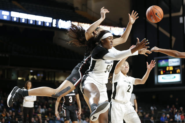 Vanderbilt forward Kaylon Smith (50) battles with South Carolina's Victaria Saxton, left, for a rebound in the first half of an NCAA college basketball game Sunday, Jan. 12, 2020, in Nashville, Tenn. (AP Photo/Mark Humphrey)