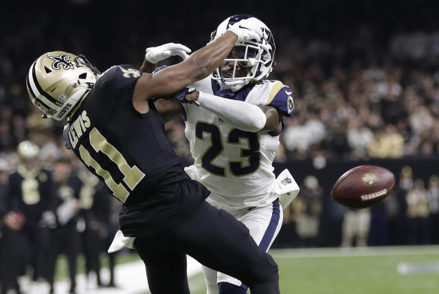 FILE - In this Jan. 20, 2019, file photo, Los Angeles Rams' Nickell Robey-Coleman breaks up a pass intended for New Orleans Saints' Tommylee Lewis during the second half of the NFL football NFC championship game in New Orleans. Reviewing penalty calls, including pass interference, will be among proposals NFL owners will hear to expand the use of replay when they meet next week in Phoenix. Expanding replay has become a scorching topic since the NFC championship game, when a non-call on a blatant pass interference and helmet-to-helmet hit by Rams defensive back Nickell Robey-Coleman likely cost the Saints a trip to the Super Bowl. (AP Photo/Gerald Herbert, File)