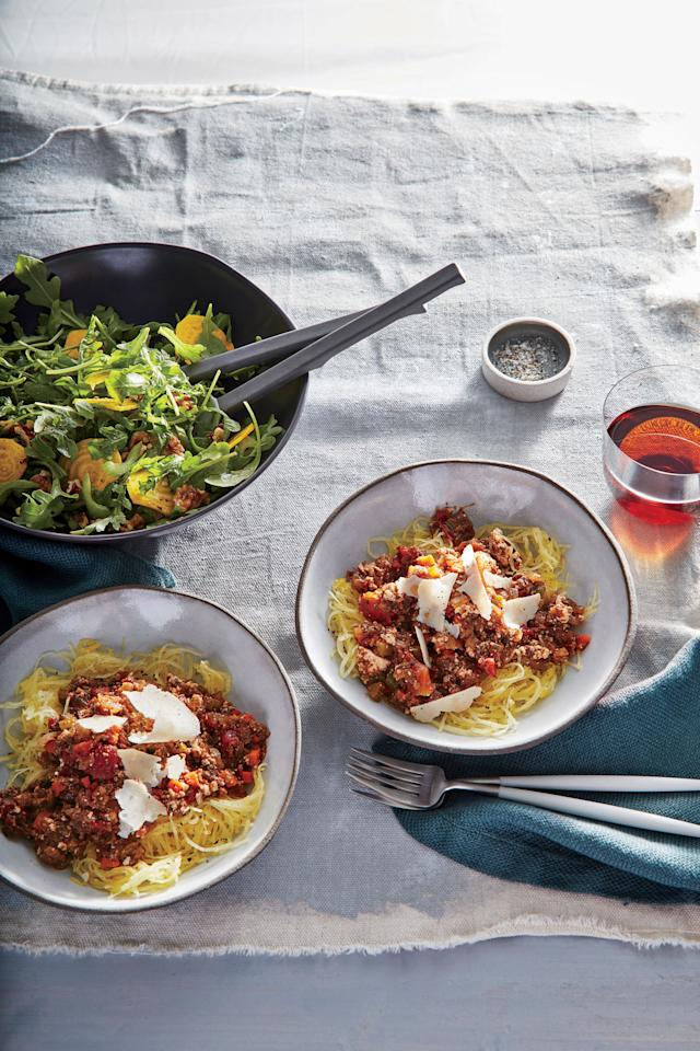 """<p>We swap traditional pasta for gluten-free spaghetti squash in this meatless main. Roasted until tender and scraped with a fork, the squash comes apart in noodle-like strands that hold the sauce well. Roast an extra squash, scrape out the flesh, and store in zip-top plastic bags for a quick side during the week. A blend of mushrooms—dried porcini and fresh cremini and button—mimic the texture of ground beef while adding plenty of savory depth. You could substitute 1/4 cup of the canned tomato liquid for a dry red wine to add even more body to the sauce.</p> <p> <a href=""""https://www.cookinglight.com/recipes/mushroom-bolognese-over-spaghetti-squash"""">View Recipe: Mushroom Bolognese Over Spaghetti Squash</a></p>"""