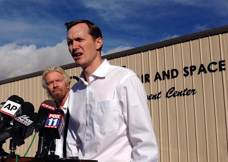 Shown here at a press conference following the 2014 crash of their spaceship Virgin Galactic founder Richard Branson, left, and CEO George Whitesides address reporters. The NTSB investigation found that poor design led to the pilot-error that caused the crash. Virgin then formed its own company, The Spaceship Company, to build its own redesigned craft in the wake of the incident.