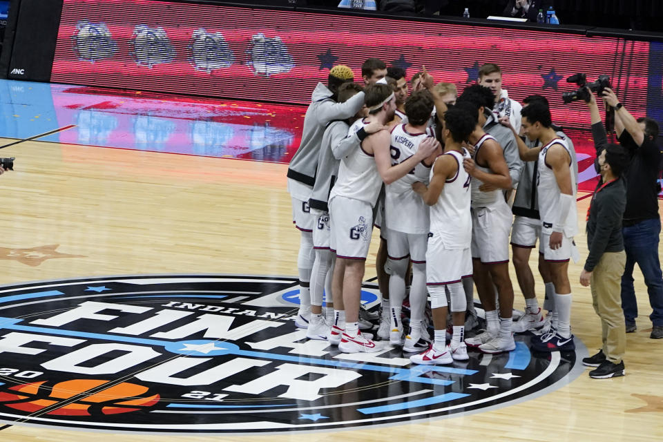 Gonzaga players huddle on the court after a men's Final Four NCAA college basketball tournament semifinal game against UCLA, Saturday, April 3, 2021, at Lucas Oil Stadium in Indianapolis. Gonzaga won 93-90 in overtime. (AP Photo/Darron Cummings)