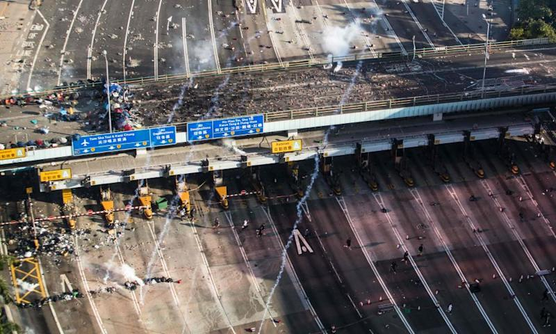 A barricade on bridge over the approach to the cross-harbour tunnel that was the scene of clashes between police and protesters.