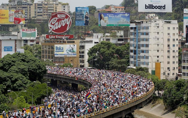 """Demonstrators rally during the so-called """"mother of all marches"""" against Venezuela's President Nicolas Maduro - Credit: Reuters"""