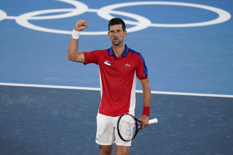 Novak Djokovic, of Serbia, celebrates after defeating Kei Nishikori, of Japan, during the quarterfinals of the tennis competition at the 2020 Summer Olympics, Thursday, July 29, 2021, in Tokyo, Japan. (AP Photo/Seth Wenig)