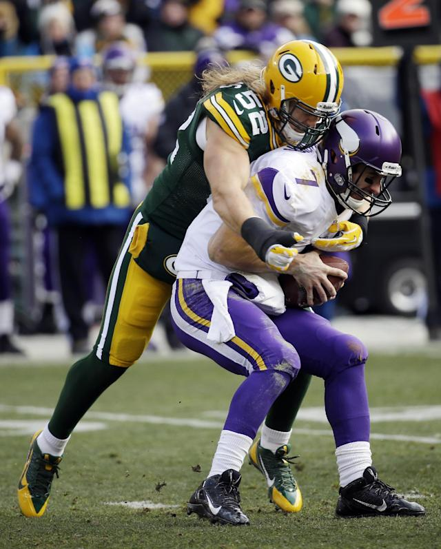 Green Bay Packers' Clay Matthews sacks Minnesota Vikings quarterback Christian Ponder during the first half of an NFL football game Sunday, Nov. 24, 2013, in Green Bay, Wis. (AP Photo/Mike Roemer)
