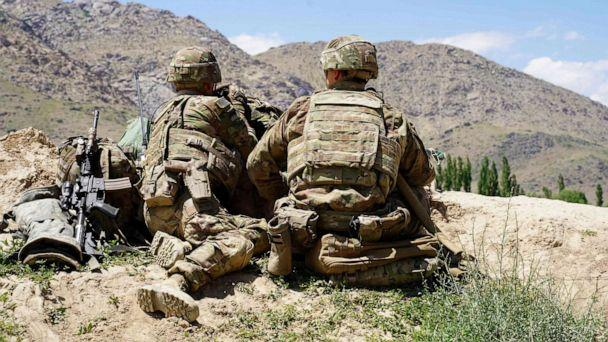PHOTO: In this photo taken on June 6, 2019, U.S. soldiers look out over hillsides during a visit of the commander of U.S. and NATO forces in Afghanistan Gen. Scott Miller at the Afghan National Army (ANA) checkpoint in Nerkh district of Wardak province. (Thomas Watkins/AFP/Getty Images)